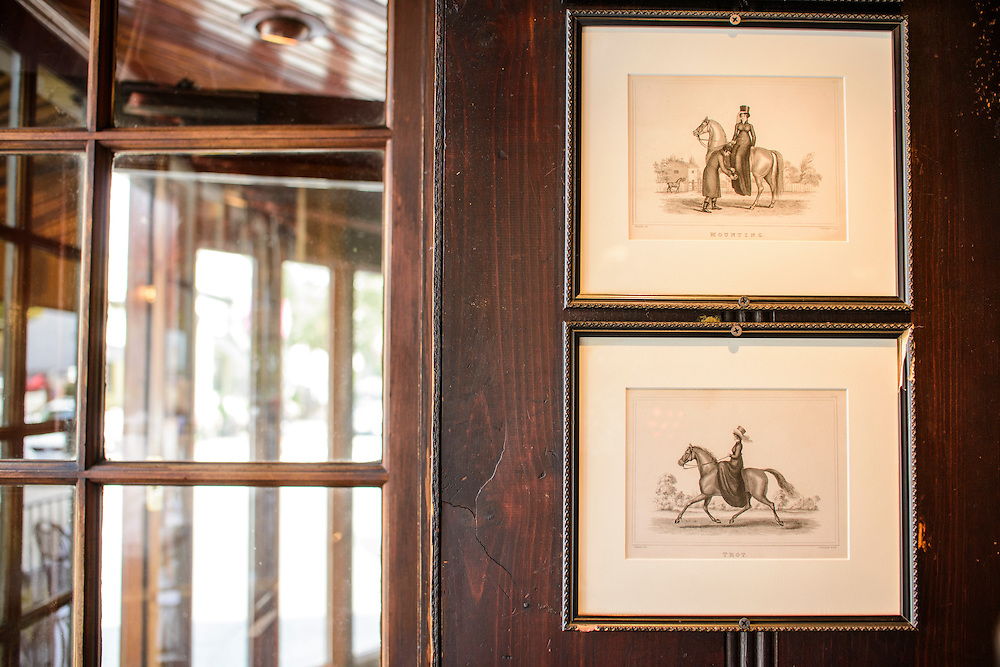 Photo by Matt Roth<br /> Assignment ID: 30146508A<br /> <br /> Framed Equestrian illustrations line the wall of Martin's Tavern. <br /> <br /> Martin's Tavern in the Georgetown area of  Washington, D.C. boasts to have served every president since Harry Truman before they became president -- except Obama. While Kennedy was a Senator he used to sit in the Rumble Seat and read his paper during brunch. Two tables over, next to the Nixon table, is where JFK allegedly proposed to Jacqueline Bouvier. The dugout, which is currently under renovation, where President Lyndon Johnson and House Speaker Sam Rayburn would sit and drink in the corner booth.<br /> <br /> Tuesday, August 20, 2013