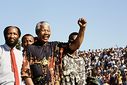 NELSON ROLIHLAHLA MANDELA (July 18, 1918 - December 5, 2013), 95, world renown civil rights activist and world leader. Mandela emerged from prison to become the first black President of South Africa in 1994. As a symbol of peacemaking, he won the 1993 Nobel Peace Prize. Joined his countries anti-apartheid movement in his 20s and then the ANC (African National Congress) in 1942. For next 20 years, he directed a campaign of peaceful, non-violent defiance against the South African government and its racist policies and for his efforts was incarcerated for 27 years. Remained strong and faithful to his cause, thru out his life, of a world of peace. Transforming the world, to make it a better place. PICTURED: 1994 - Nelson Mandela greets ANC supporters during the 1994 election camapign that led to his ANCs victory in the first democratic, non racial election in South Africa.  (Credit Image: © Greg Marinovich/ZUMA Wire/ZUMAPRESS.com)