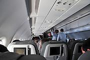 Interior of an economy class cabin during an international flight
