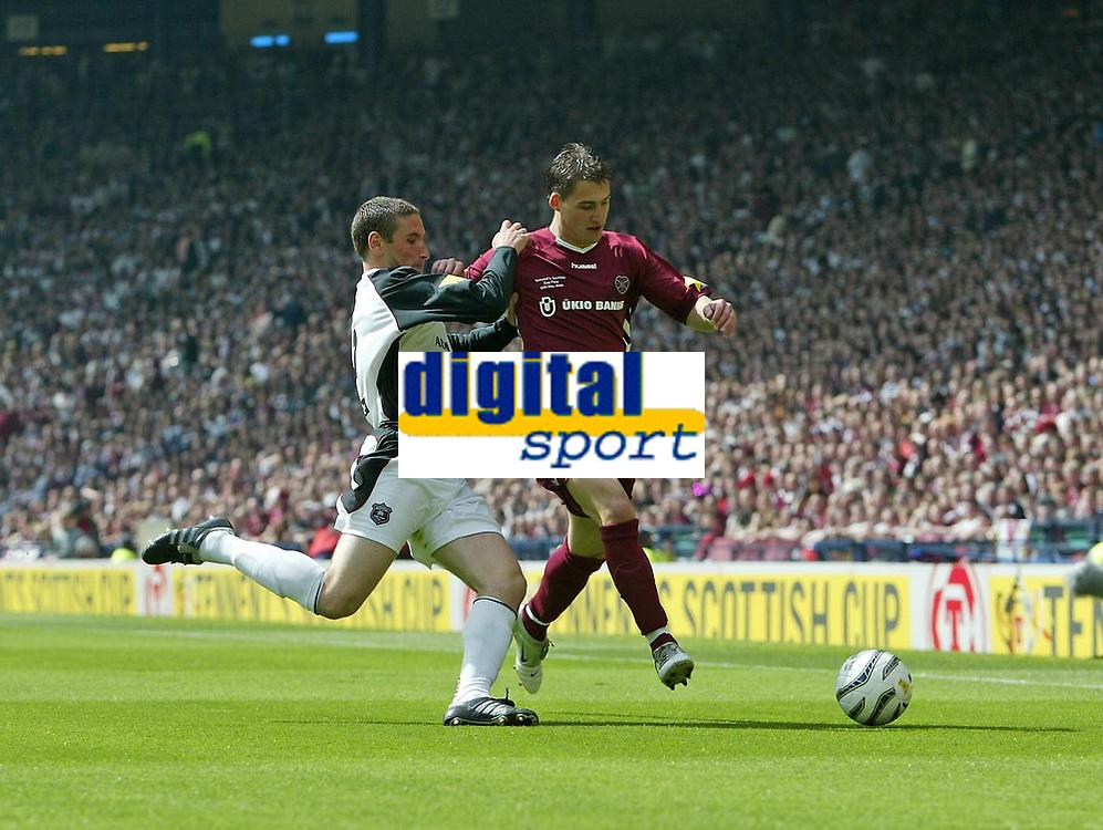 Photo: Andrew Unwin.<br /> Hearts v Gretna. Tennants Scottish Cup Final. 13/05/2006.<br /> Gretna's Mark Birch (L) slides in on Hearts' Rudi Skacel (R).