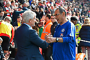 Southampton manager Mark Hughes and Chelsea manager Maurizio Sarri shake hands before the Premier League match between Southampton and Chelsea at the St Mary's Stadium, Southampton, England on 7 October 2018.