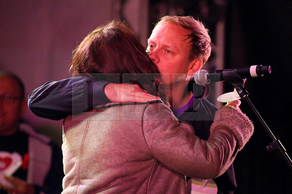 """© Licensed to London News Pictures. 29/08/2011. Manchester, UK. A teary Antony Cotton hugs fellow Coronation Street star, Debbie Rush, in between speeches during the Candlelit Vigil at the end of the 21st annual Manchester Gay Pride. The event is held to commemorate those who have died from and are living with HIV. The event is held in Sackville Park in Manchester's """"Gay Village"""". Photo credit : Joel Goodman/LNP"""