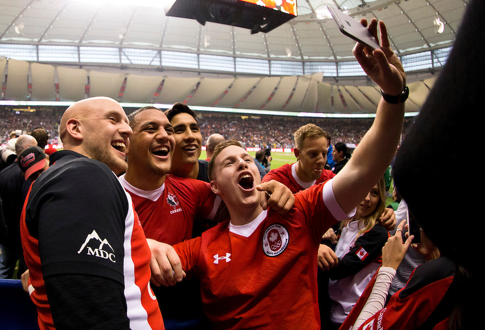 Lucas Hammond of Canada takes a selfie with Mike Fuailefau after playing France in the Bowl Final at the HSBC Sevens World Series XVII Round 6 at B.C. Place Stadium in Vancouver British Columbia on March 13, 2016. Canada beat France 19-17.(KevinLight/CBCSports)