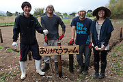 Group portrait of Susumu Hakesaki, Seiji Kanari, Tomomi Kanno and another volunteer farmer at the Arigato Farm project, Ogawa Machi, Iwaki, Fukushima, Japan. Sunday May 6th 2012