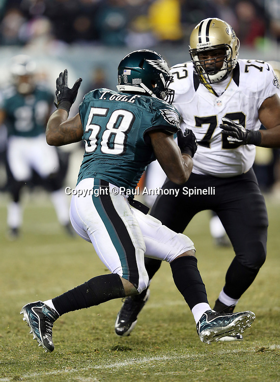 Philadelphia Eagles outside linebacker Trent Cole (58) is blocked by New Orleans Saints offensive tackle Terron Armstead (72) during the NFL NFC Wild Card football game against the New Orleans Saints on Saturday, Jan. 4, 2014 in Philadelphia. The Saints won the game 26-24. ©Paul Anthony Spinelli