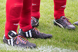 © Licensed to London News Pictures . 22/09/2013 . Lancing , UK . Shadow Chancellor Ed Balls ' rainbow laces (nearest) worn in support of an anti homophobia in football campaign . Labour Party vs journalists football match . Day 1 of the Labour Party 's annual conference in Brighton . Photo credit : Joel Goodman/LNP