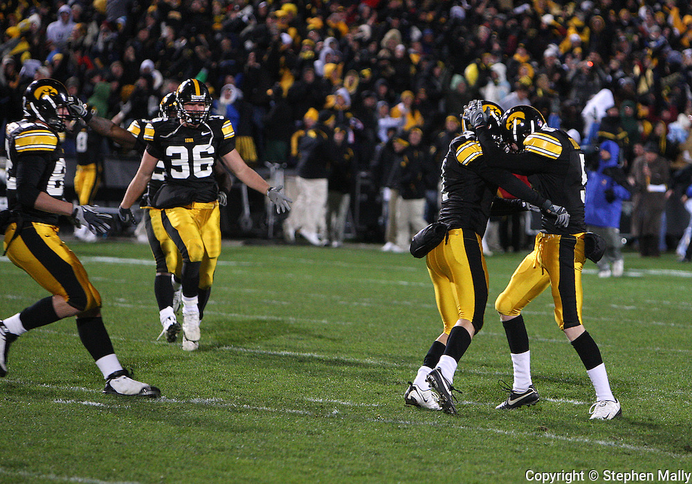 08 NOVEMBER 2008: Iowa holder Ryan Donahue (5) celebrates with Iowa kicker Daniel Murray (1) after Murray kicked the game winning 31 yard field goal in the second half of an NCAA college football game against Penn State, at Kinnick Stadium in Iowa City, Iowa on Saturday Nov. 8, 2008. Iowa beat Penn State 24-23.