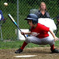 Jackson Rybicki of the Lunberg Gustafson Astro's ducks under a pitch at Michael LaGrega Memorial field 6-18 photo by Mark L. Anderson