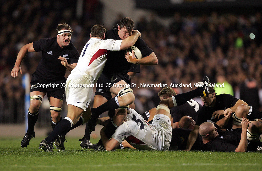 Chris Jack is tackled by Trevor Woodman during the All Blacks Test match against England at Eden Park, Auckland, New Zealand, on Saturday 19 June, 2004. The All Blacks defeated England,36 -12.<br />