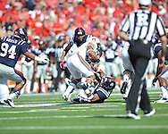 Ole Miss linebacker Denzel Nkemdiche (4) tackles Auburn running back Tre Mason (21) at Vaught-Hemingway Stadium in Oxford, Miss. on Saturday, October 13, 2012. (AP Photo/Oxford Eagle, Bruce Newman)..