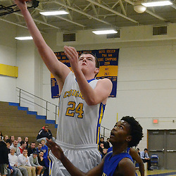 Staff photos by Tom Kelly IV<br /> East's Cary Angeline (24) goes up for a layup during the Downingtown East vs Ben Franklin game at Downingtown West High School on Friday December 6, 2013.