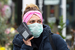 ©Licensed to London News Pictures 19/03/2020<br /> Maidstone, UK. A lady wearing a mask. Coronavirus threat to People out and about in Maidstone High Street, Kent. Photo credit: Grant Falvey/LNP