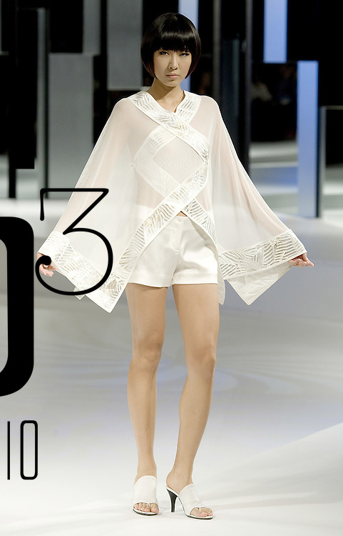 HONG KONG - JULY 7: A model walks down the runway with a creation by Japanese designer Kinji at the 'Zen' show during the Hong Kong Fashion Week S/S 2010 on July 7, 2009 in Hong Kong. Photo by Victor Fraile / studioEAST