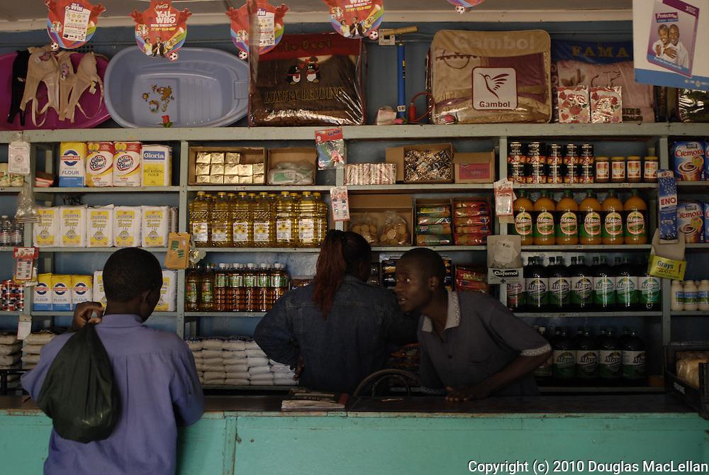 Zimbabwe, Nyachuru Township. May 2010. Zimtrac General Dealer. MACHINGURA Clayton, shopkeeper; TANYANYIWA POSIWE, owner.