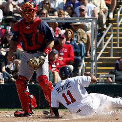 March 11, 2011; Fort Myers, FL, USA; Minnesota Twins center fielder Ben Revere (11) slides into home past Boston Red Sox catcher Jason Varitek (33)during a spring training exhibition game at Hammond Stadium.   Mandatory Credit: Derick E. Hingle