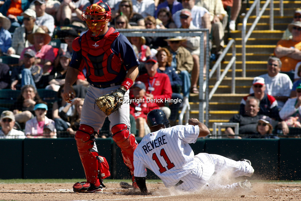 March 11, 2011; Fort Myers, FL, USA; Minnesota Twins center fielder Ben Revere (11) slides into home past Boston Red Sox catcher Jason Varitek (33)during a spring training exhibition game at Hammond Stadium.   Mandatory Credit: Derick E. Hingle