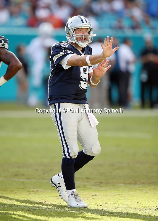 Dallas Cowboys quarterback Tony Romo (9) holds up his hands indicating stop as he gestures toward the bench area during the 2015 week 11 regular season NFL football game against the Miami Dolphins on Sunday, Nov. 22, 2015 in Miami Gardens, Fla. The Cowboys won the game 24-14. (©Paul Anthony Spinelli)