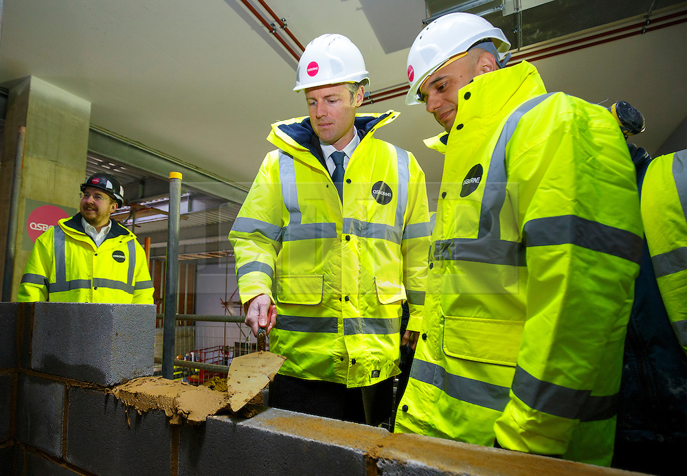 © Licensed to London News Pictures. 15/03/2016. London, UK. Conservative candidate for Mayor of London Zac Goldsmith and Business Secretary Sajid Javid laying bricks as they visit the construction site of Barnet & Southgate College's new campus to unveil Zac Goldsmith's new housing pledges as part of his action plan for Greater London. Photo credit: Tolga Akmen/LNP