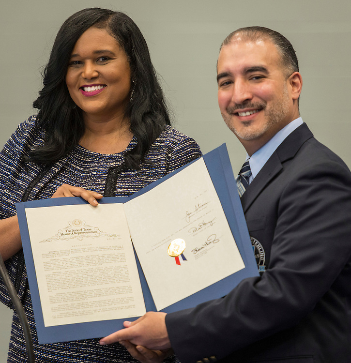 Shawn Thierry presents a certificate of recognition to Justin Fuentes during a ribbon cutting ceremony at Sterling High School, March 3, 2017.