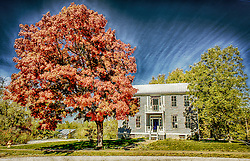 Autumn sets in and trees begin to change in this fine art interpretation of sweeping skies and vibrant foliage around this old character home in New Melle, Missouri.