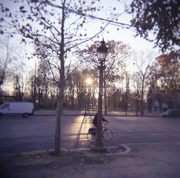 Cyclist near Tulliers gardens Paris France photograph taken with Holga film camera