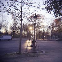 Cyclist near Tulliers gardens Paris France photograph taken with Holga film camera