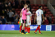 Players shake hands at full time during the U21 UEFA EURO first qualifying round match between England and Scotland at the Riverside Stadium, Middlesbrough, England on 6 October 2017. Photo by Paul Thompson.