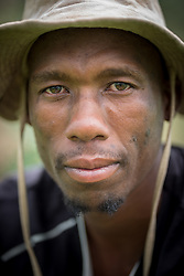 """3 March 2017, Thaba Bosiu, Lesotho: Farmer David Moshoeshoe is 33 years old. He lives on the hillside of Thaba Bosiu, """"Night Mountain"""" in Thaba Bosiu, Lesotho, where he grows vegetables, mainly cabbage and spinach. Thaba Bosiu is a sandstone plateau some 24 kilometers east of Lesotho's capital, Maseru. The name means Night Mountain, and surrounding the plateau is a small village and open plains. Thaba Bosiu was once the capital of Lesotho, and the mountain was the stronghold of the Basotho king when the kingdom of Lesotho was formed."""