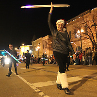 Adam Robison | BUY AT PHOTOS.DJOURNAL.COM<br /> Deb Fooshee, of Mooreville, walks with the Hoopelo group, with her hula hoop during the Tupelo Christmas Parade Friday night.