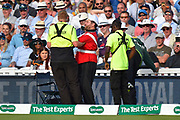 Stewards remove a fan dressed as a guardsman from the edge of the field during the 5th International Test Match 2019 match between England and Australia at the Oval, London, United Kingdom on 14 September 2019.
