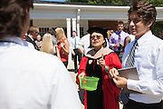 New students meet faculty after the College of Business Freshman Convocation outside of Nelson Commons, on Saturday, August 22, 2015. Photo by Kaitlin Owens