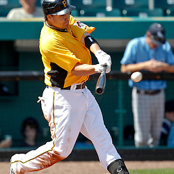 February 25, 2011; Bradenton, FL, USA; Pittsburgh Pirates first baseman Steve Pearce (51) hits an double scoring a run during a spring training exhibition game against the State College of Florida Manatees at McKechnie Field. The Pirates defeated the Manatees 21-1. Mandatory Credit: Derick E. Hingle