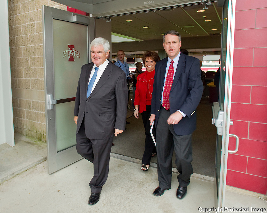 Former House Speaker Newt Gingrich (from left) leaves Jack Trice Stadium with Iowa House Representative Linda Upmeyer (R-IA12), and American Solutions National Director Michael Krull after speaking to the Team Iowa PAC during a luncheon in Ames, Iowa on Thursday September 9, 2010. (Stephen Mally for The New York Times)