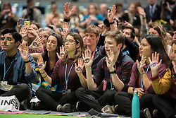 13 December 2019, Madrid, Spain: Young people show the palms of their hands, on which they have drawn eyes, in an action at COP25.. As COP25 is about to draw to a close, hundreds of young people mobilize through Fridays for Future in a strike for the climate, inside and outside the venue of COP25 in Madrid, calling for urgent action for climate justice.