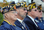 From left, Elmont Cheeseman, Gene Tecce and VFW Commander Thomas Hauserman listen to a speaker during the Yardley Veteran's Day ceremony Wednesday November 11, 2015 in Yardley, Pennsylvania.  (Photo by William Thomas Cain)