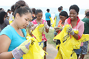 Youth participate in a beach clean up exercise organized by Southern Durban Community Environmental Alliance (SCDEA)/KZN, 1 December 2011