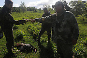 """Peter Foster (l) and Max Rowe (r) pick up the shot that felled this gobbler..""""The Spring Gobbler"""" turkey hunting season in Augusta County, Virginia with Max Rowe, 42, of the Cable TV hunting programme """"Just Kill'n Time TV"""", and Freddy McGuire, who, according to Max, is """"the best Turkey hunter I know""""..The turkey season starts in mid-April and lasts for six weeks."""