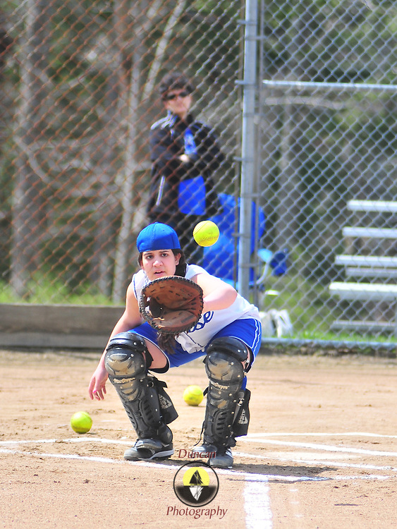 4/21/10 -- BATH, Maine. Alejandra Rodriguez warms up for a game at Tainter Field in Bath on Opening Day. Her mother watches her from behind the cage. Photo by Roger S. Duncan.