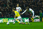 Patrick Bamford of Leeds United (9) is fouled by Ben Pearson of Preston North End (4) during the EFL Sky Bet Championship match between Preston North End and Leeds United at Deepdale, Preston, England on 9 April 2019.