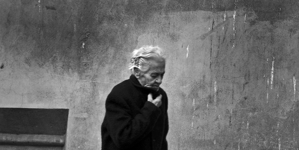 Old woman in Bologna winter.