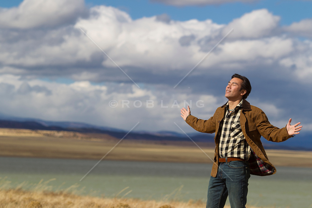 man outdoors feeling the wind