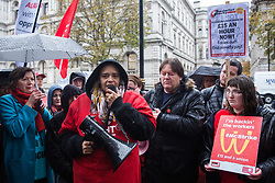 London, UK. 12 November, 2019. Melissa Evans, a striking McDonald's worker from Wandsworth Town, addresses fellow McDonald's workers belonging to the Bakers Food & Allied Workers Union (BFAWU) assembled opposite Downing Street during strike action, dubbed a 'McStrike', to call for a New Deal for McDonald's Workers which would include £15 an hour, an end to youth rates, the choice of guaranteed hours of up to 40 hours a week, notice of shifts four weeks in advance and union recognition.