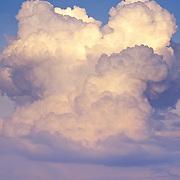 Incredible thunderhead building in a fair sky on a late summer afternoon