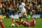 Mohamed Diamé (Hull City) is tackled by Adam Clayton (Middlesbrough) during the Sky Bet Championship match between Middlesbrough and Hull City at the Riverside Stadium, Middlesbrough, England on 18 March 2016. Photo by Mark P Doherty.