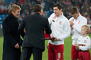 (L) Zbigniew Boniek and (2L) Dariusz Dziekanowski and (C) Poland's Robert Lewandowski with trophy before international friendly soccer match between Poland and Ireland at Inea Stadium in Poznan on November 19, 2013.<br /> Robert Lewandowski will play 60 match for the national team in his career.<br /> He will become a member of Outstanding Club Representative.<br /> <br /> Poland, Poznan, November 19, 2013<br /> <br /> Picture also available in RAW (NEF) or TIFF format on special request.<br /> <br /> For editorial use only. Any commercial or promotional use requires permission.<br /> <br /> Mandatory credit:<br /> Photo by &copy; Adam Nurkiewicz / Mediasport