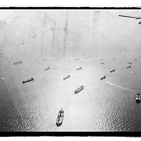 Where: Flight out of Singapore. <br /> <br /> I love this shot. I added an artistic element to the image. The ships out at sea make a striking image. Especially with the sun reflection in the ocean.