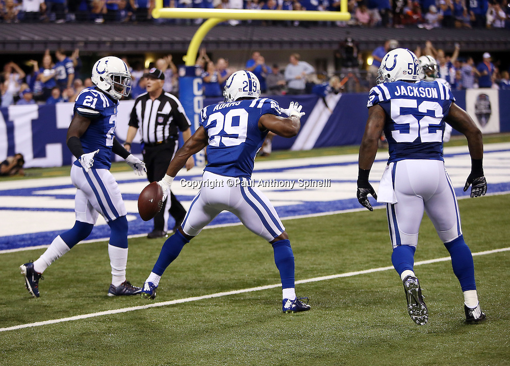 Indianapolis Colts strong safety Mike Adams (29) celebrates with Indianapolis Colts cornerback Vontae Davis (21) and Indianapolis Colts inside linebacker D'Qwell Jackson (52) after intercepting an end zone pass intended for New York Jets wide receiver Brandon Marshall (15) and stopping a Jets drive during the 2015 NFL week 2 regular season football game against the New York Jets on Monday, Sept. 21, 2015 in Indianapolis. The Jets won the game 20-7. (©Paul Anthony Spinelli)