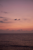 Pastel colored sky and clouds over the Pacific Ocean at dawn.  Image 5 of 21  for a panorama taken with a Fuji X-T1 camera and 35 mm f/1.4 lens  (ISO 400, 35 mm, f/2.8, 1/30 sec). Raw images processed with Capture One Pro and stitched together with AutoPano Giga Pro.