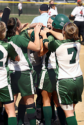 05 April 2008: Team celebration after homerun.  The Carthage College Lady Reds lost the first game of this double header to the Titans of Illinois Wesleyan 4-1 at Illinois Wesleyan in Bloomington, IL