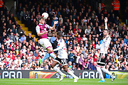 Aston Villa defender Tommy Elphick (6) heads the ball during the EFL Sky Bet Championship match between Fulham and Aston Villa at Craven Cottage, London, England on 17 April 2017. Photo by Jon Bromley.